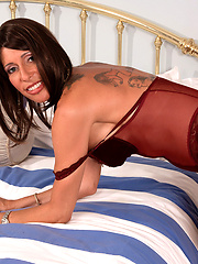Tattoed mature in sexy brown corset