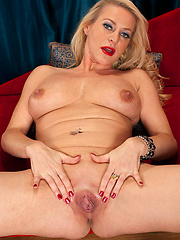 Blond mature shows her shaved pussy