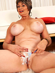 Aged mature shaving pussy