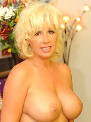 Hot 50 Plus slut takes a huge cum blast to the eyes!