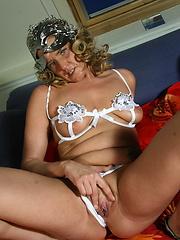 Naughty housewife feeling herself up