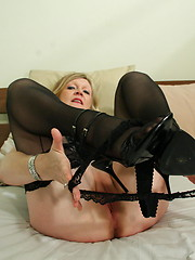 Blonde housewife shows her pussy and plays with it