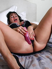 Brunette housewife playing with her pink toy