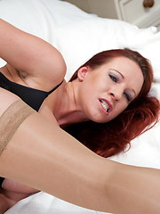 Hot red-haired mature in stockings loves her hole