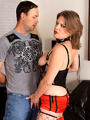 Perverted mature in leather clothes plays with cock