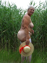 Naughty mama playing with herself in the grass