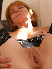 Mom putting her hand into own vagina