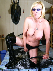 Blonde mature in dark leather boots