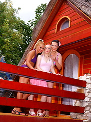 Trio of young and old lesbians have fun on the backyard