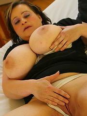 Busty mom slaps her round ass and play with sex toy