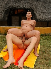 Horny granny Margo T is fucking with a younger guy