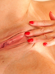 Mature stewardess shows off her tits and spreads her shaved pussy