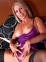Jenny Mason teasingly flaunts her mature body in violet lingerie