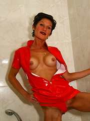Look at this amazing mature in red latex lingerie
