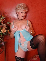 Sexy blond granny spreading her legs