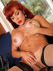 Redhead housewive in stockings have solo session at the kitchen