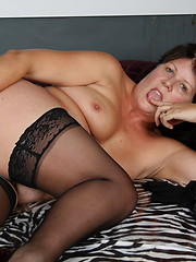Beauty chubby mature in stockings grabs her hole by pink sextoy