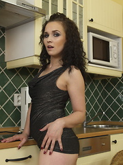 Naughty mom playing in the kitchen