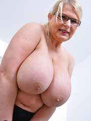 Huge breasted housewife playing with her big knockers