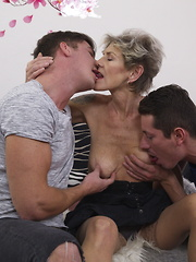 Naughty mature lady doing two guys at once