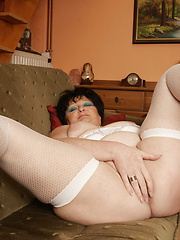 Horny mature slut playing with herself