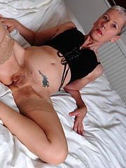 Horny mature slut playing with her dildo