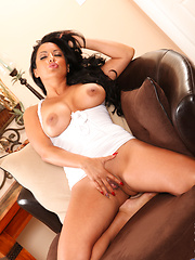Cougar milf gets busy stroking her perky assets with her hands on the couch