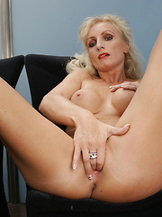 Horny MILF feeling naughty at home