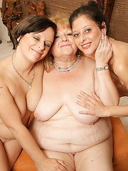 These three old and young lesbians make out on the couch