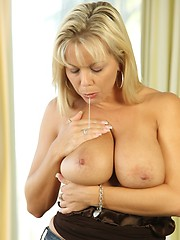 Amber Lynn Bach, the sexy MILF plays with her big dildo.