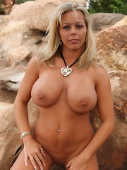 Amber Lynn Bach shows off her beautiful body in a sexy bikini then strips it off.