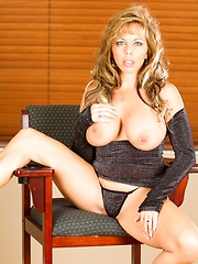 Sexy MILF Amber Lynn Bach shows off her curvy body in her tight black dress and then plays with her pussy.