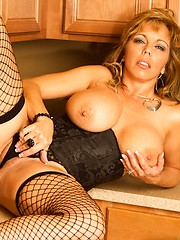 Amber Lynn Bach looks so hot in her thigh highs and waist cincher.