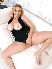Seductive blonde cougar shows off her huge Anilos tits