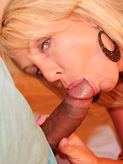 Big tittied blonde bouncing on a huge black cock
