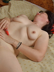Horny hairy housewife masturbating