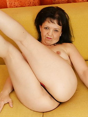 This horny housewife shows off on her couch
