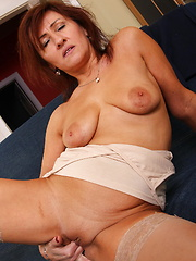 mature babe getting herself wet