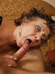 Naughty mature slut playing with her toy boy