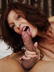Horny cougar sucking a big hard cock