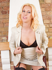 Gorgeous blonde milf strips down and gets naughty with a dildo