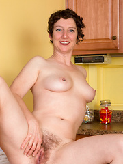 Short haired mommy spreads her hairy pussy in the kitchen