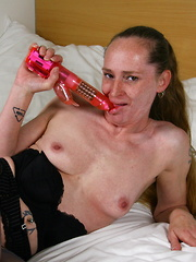 Naughty Dutch housewife playing in her bed