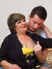 Naughty mature lady playing with hertoy boy
