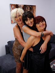 Three old and young lesbians getting wet on the couch