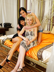 Three old and young lesbians making out in bed