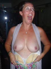 Next door housewives showing their tits in a night bar