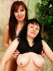 Hairy pussy MILF gets her furry snatch gouged out by a sexy lesbian's tongue!