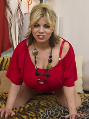 Big breasted housewife showing off her dirty mind