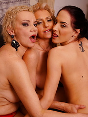 Three old and young lesbians having fun together